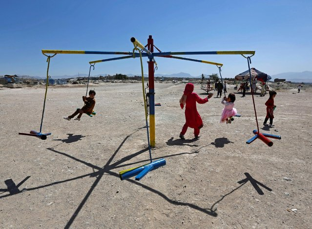Afghan children ride on swings during the first day of the Muslim holiday of Eid al-Fitr, which marks the end of the holy month of Ramadan, in Kabul, Afghanistan July 6, 2016. (Photo by Omar Sobhani/Reuters)