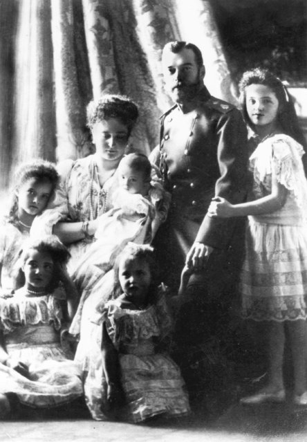 Tsar Nicholas II of Russia (1868–1918), with his wife, Alexandra Feodorovna (1872–1918), and their five children. Empress Alexandra holds the baby Tsarevich Alexis (1904–1918), surrounded by the Grand Duchesses Olga, Tatiana, Marie and Anastasia, circa 1905. All perished at Ekaterinberg in July 1918.