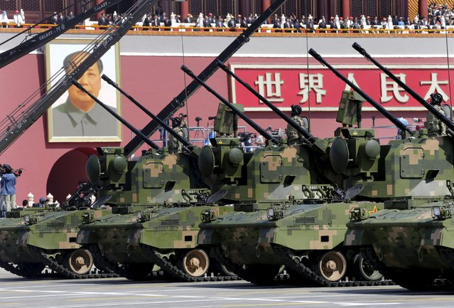 Anti-aircraft artilleries drive past Tiananmen Gate during a military parade to mark the 70th anniversary of the end of World War Two, in Beijing, China, September 3, 2015. (Photo by Jason Lee/Reuters)