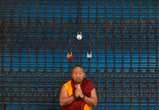 A Buddhist monk offers a prayer at Boudhanath Stupa during the birth anniversary of Buddha, also known as Vesak Day, amid the lockdown imposed by the government over concerns about the spread of the coronavirus disease (COVID-19) in Kathmandu, Nepal on May 7, 2020. (Photo by Navesh Chitrakar/Reuters)