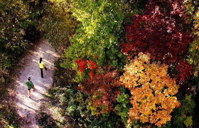 Two joggers make their way down one of the hiking trails amongst the changing colors on the tree tops at Pike Lake in Hartford, Wisconsin, on September 26, 2012. (Photo by John Ehlke/West Bend Daily News)