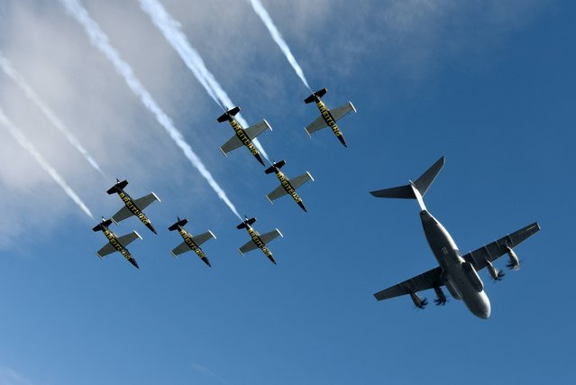 Seven L-39c Albatros aircraft from the Breitling Jet Team in the process of joining up for a formation flight with the latest offering from Airbus over Toulouse, France, on Saturday, September 20, 2014. The Airbus A400M is a strategic military aircraft for Intercontinental or long range missions, with also the ability to bring relief for humanitarian efforts to remote, dangerous or inhospitable regions around the globe.(Photo by Katsuhiko Tokunaga/Breitling via AP Images)
