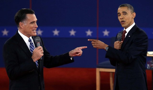 Republican candidate Mitt Romney and President Barack Obama spar during the second presidential debate, at Hofstra University in Hempstead, N.Y.,  October 16, 2012 (Photo by Charlie Neibergall/Associated Press)