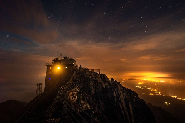 A long time exposed picture taken by night shows the Solar observatory at the peak of the Lomnicky Stit, in the Slovakia's High Tatras mountains, on September 04, 2014. The coronal station at Lomnicky Stit observatory, built at 2 632 meters between 1957 and 1962, ranks among five existing stations worldwide which systematically observe emission spectral lines of the corona. (Photo by Joe Klamar/AFP Photo)