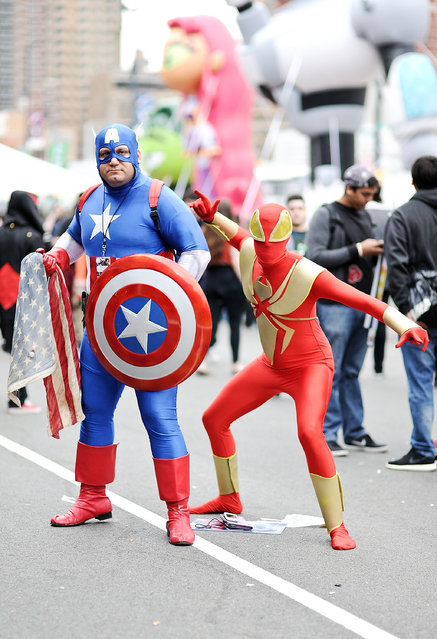 Comic Con attendees pose as Captain America and Spiderman during the 2014 New York Comic Con at Jacob Javitz Center on October 10, 2014 in New York City. (Photo by Daniel Zuchnik/Getty Images)