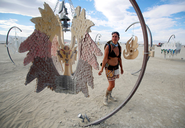 Sandra Mallet views an art installation as approximately 70,000 people from all over the world gather for the 30th annual Burning Man arts and music festival in the Black Rock Desert of Nevada, U.S. August 29, 2016. (Photo by Jim Urquhart/Reuters)