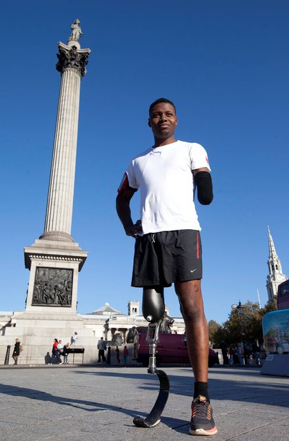 Former Royal Marine Commando Ben McBean, 27, from Plymouth, on his 31-mile run through the streets of London, creating the outline of a poppy on the London map with the aid of a smartphone running app and Vodafone's network, ahead of Remembrance Day to raise money for the Royal British Legion's Poppy Appeal, on October 28, 2014. Ben's run is part of the Vodafone Firsts programme, which is about inspiring people to do something remarkable for the first time with the help of Vodafone's technology. (Photo by David Parry/PA Wire)