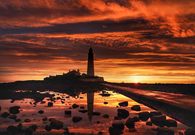 The sun rises at St Mary's Lighthouse in Whitley Bay on July 30, 2020, as the Met Office said Friday may be the hottest day of the year so far despite following an unseasonably chilly July. (Photo by Owen Humphreys/PA Images via Getty Images)
