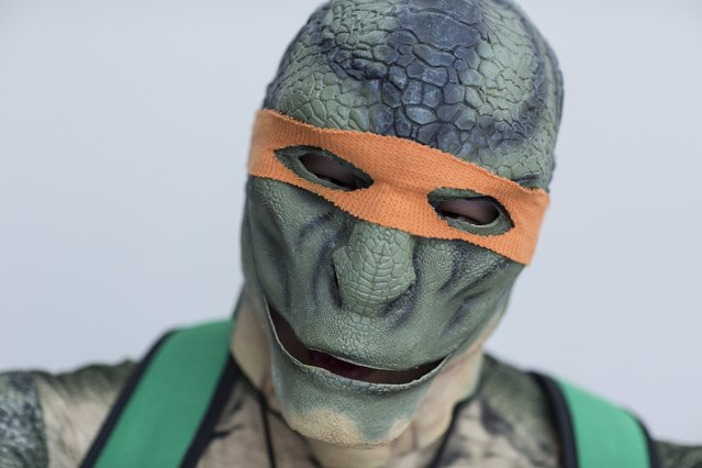 Julian Park attends New York Comic Con dressed as Michelangelo from Teenage Mutant Ninja Turtles in Manhattan, New York, October 8, 2015. (Photo by Andrew Kelly/Reuters)