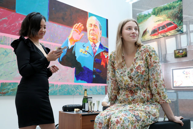 Visitors at the 8th Cosmoscow International Fair at Gostinny Dvor in Moscow, Russia on September 10, 2020. Cosmoscow is an annual art festival and exhibition of works by contemporary artists. (Photo by Sergei Karpukhin/TASS)