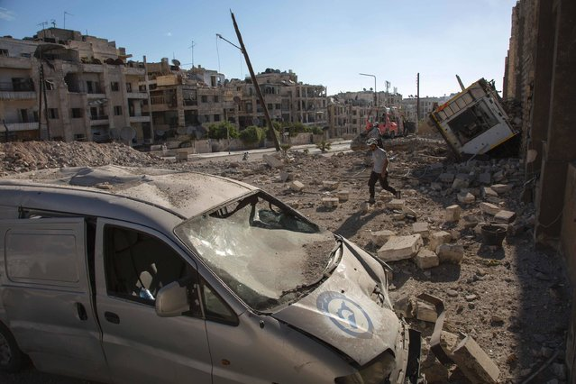 A picture shows destruction following an air strike in the rebel-held Ansari district in the northern Syrian city of Aleppo on September 23, 2016. Syrian and Russian aircraft pounded rebel-held areas of Aleppo, a monitor said, after the army announced a new offensive aimed at retaking all of the divided second city. An AFP correspondent in the opposition-held east of the city reported relentless bombardment with air strikes, barrel bombs and artillery fire hitting multiple neighbourhoods. (Photo by Karam Al-Masri/AFP Photo)
