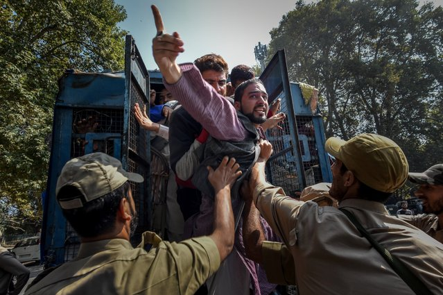 Indian government forces detain a supporter of Engineer Abdul Rashid of Awami Ithaad Party, a pro-Indian political party, during a protest march towards the United Nations Military Observer Group in India and Pakistan (UNMOGIP) to protest against the recent killings of civilians by Indian government forces on September 26, 2016. Currently 87 civilians have been killed and over 13000 Injured during the fierce protests over the killing of a young rebel commander Burhan Wani as an ongoing unrest in Indian controlled Kashmir enters its 79th day. The violence in the area is the worse since 2010 and the protests have triggered a heavy crackdown by Indian government forces which include many strict curfews. (Photo by Yawar Nazir/Getty Images)