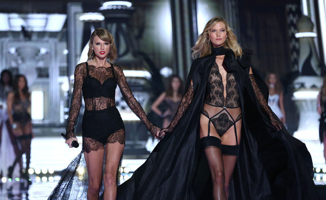 Taylor Swift and Karlie Kloss walk the runway at the annual Victoria's Secret fashion show at Earls Court on December 2, 2014 in London, England. (Photo by Tim P. Whitby/Getty Images)