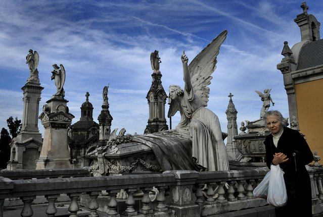 A woman walks in front of the pantheon of the Marquesa de San Juan de Nieva, chosen as the best tomb sculpture of Spain in a Spanish magazine this week, in the municipal cemetery of La Carriona in Aviles, northern Spain, October 29, 2015. (Photo by Eloy Alonso/Reuters)