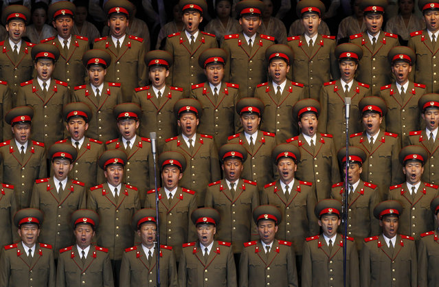 In this April 16, 2012 photo, North Korean soldiers sing at the Pyongyang indoor gymnasium to commemorate late president Kim Il Sung's 100th birthday in Pyongyang, North Korea. (Photo by Vincent Yu/AP Photo)