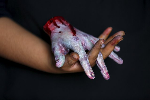 A bloody zombie hand made of gummy candy and red jelly is pictured at the Zombie Gourmet homemade candy manufacturer on the outskirts of Mexico City October 30, 2015. (Photo by Carlos Jasso/Reuters)
