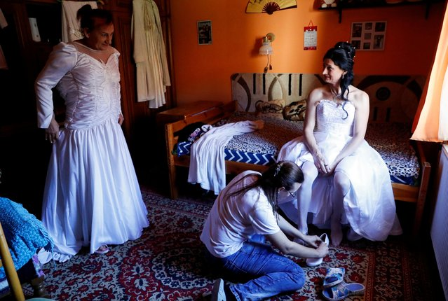 Hungarian transgender couple, Elvira Angyal and Tamara Csillag, prepare for their wedding at home in Polgardi, Hungary, November 6, 2020. In Prime Minister Viktor Orban's increasingly homophobic regime, gay people are barred from marrying while transgender people have been denied legal recognition – ironically enabling Agyal, who completed her legal transition to become a woman, to marry Csillag, who has been stuck with male documents but still lives as a woman. (Photo by Bernadett Szabo/Reuters)