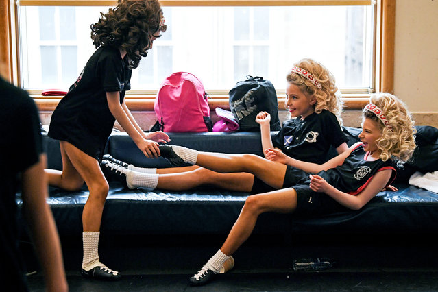 Competitors stretch before taking part in day three of the World Irish Dancing Championships on March 26, 2018 in Glasgow, Scotland. (Photo by Jeff J. Mitchell/Getty Images)