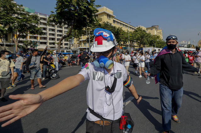 A high school student, with duct tape concealing ID tags on his school uniform,  marches in front lines during a street protest close to the Democracy Monument in Bangkok, Thailand, Saturday, November 14, 2020. (Photo by Sakchai Lalit/AP Photo)