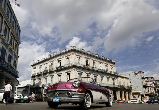 A Buick 1956 convertible drives down a street in Havana, February 5, 2010. (Photo by Desmond Boylan/Reuters)