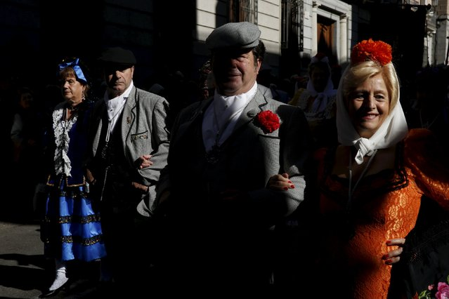"People dressed in traditional Madrid attire as ""chulapos"" and ""chulapas"" take part in a procession to celebrate Madrid's patron saint La Almudena Virgin in Madrid, Spain, November 9, 2015. (Photo by Susana Vera/Reuters)"