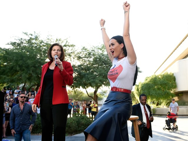Singer Katy Perry (R) cheers as former Nevada Attorney General and democratic U.S. Senate candidate Catherine Cortez Masto speaks at a get out the early vote rally as they campaign for Democratic presidential candidate Hillary Clinton at UNLV on October 22, 2016 in Las Vegas, Nevada. (Photo by David Becker/Getty Images)