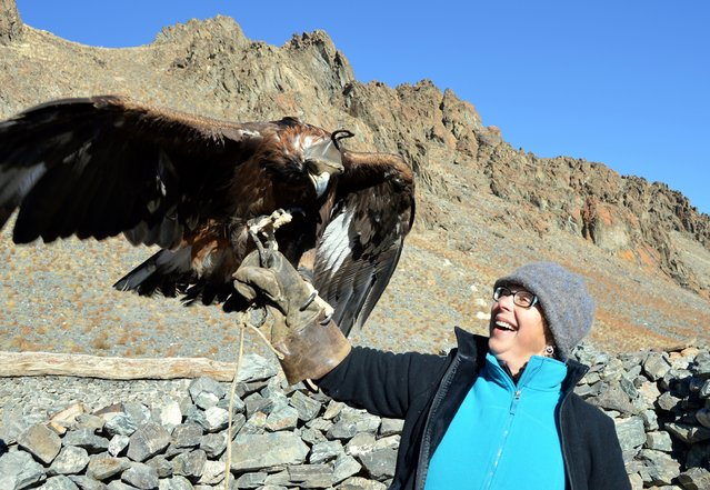 Jeanette Cox, an Adventure Sherpas client, held an eagle while visiting a hunter's home. (Photo by Brad Ruoho/The Star Tribune)