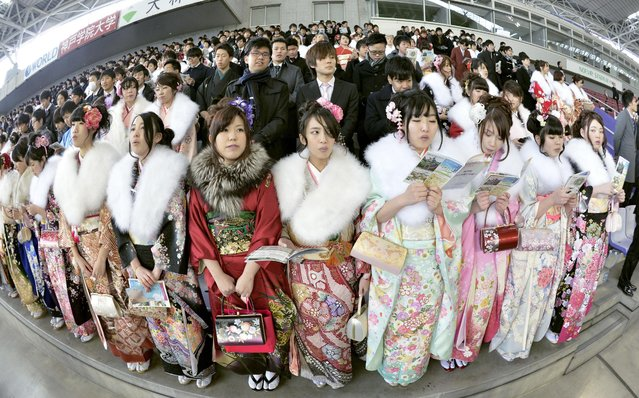 Young people in Kobe get ready to sing a song at a Coming-of-Age Day ceremony in Kobe, Hyogo Prefecture, on January 12, 2015. The song was written following the Great Hanshin Earthquake 20 years ago to encourage reconstruction in the region. (Photo by Kyodo News)