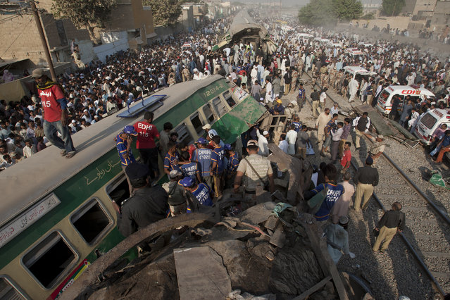 People look for victims in the wreckage of the trains in Karachi, Pakistan, Thursday, November 3, 2016.   Pakistani officials say a train crash has killed dozens of people in the southern port city. (Photo by Shakil Adil/AP Photo)