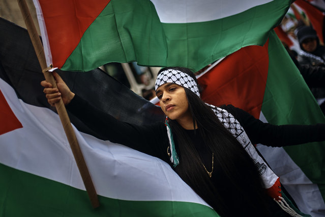 A Palestinian supporter protests against Israel during the annual Celebrate Israel parade, Sunday, June 3, 2018, in New York. (Photo by Andres Kudacki/AP Photo)