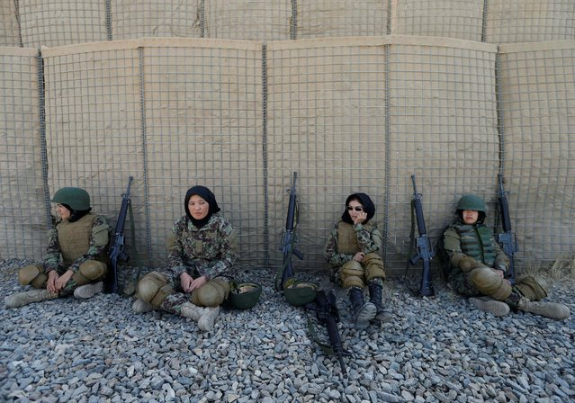 Female Afghan soldiers Shreen Yawari, 24 (L), Zarmina Ahmadi, 22 (2nd L), Fatima Alimi, 21 (3nd L), and Zahra Sultani, 20 (R), rest after shooting exercises at the Kabul Military Training Centre (KMTC) in Kabul, Afghanistan, October 26, 2016. (Photo by Mohammad Ismail/Reuters)
