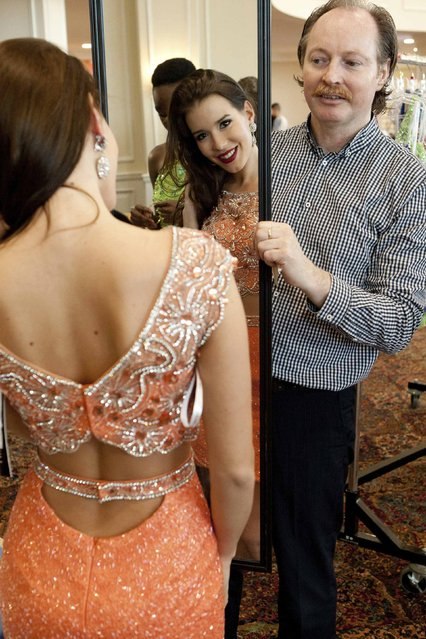 Miss Hungary 2014 Henrietta Kelemen tries on her Sherri Hill gown with wardrobe assistant Mark Zappone at the 63rd annual Miss Universe Pageant in Miami, Florida, in this January 5, 2015 handout photo provided by the Miss Universe Organization. (Photo by Reuters/Miss Universe Organization)