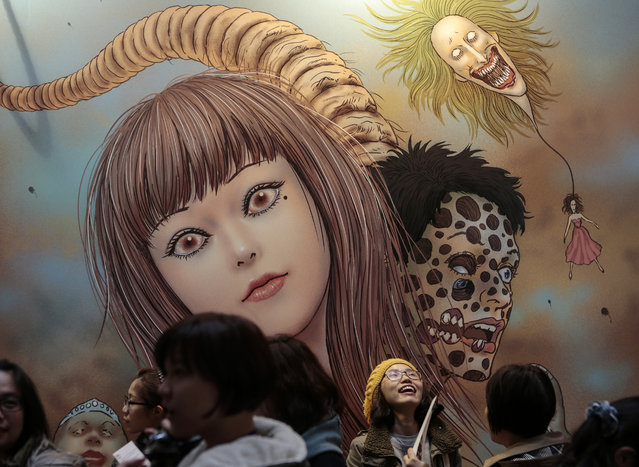 """Visitors view drawings of Japanese horror manga artist Junji Ito during the """"Experience Horror"""" exhibition in Taipei, Taiwan, December 3, 2015. (Photo by Ritchie B. Tongo/EPA)"""