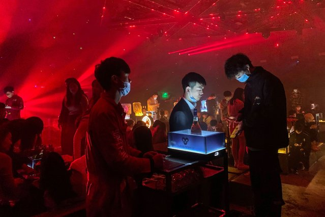In this picture taken on January 21, 2021, people visit a nightclub in Wuhan, China's central Hubei province. (Photo by Hector Retamal/AFP Photo)