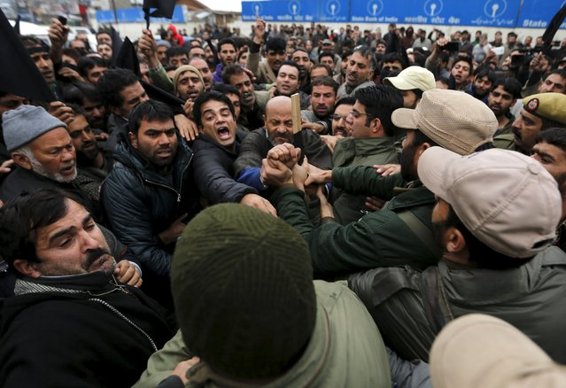 Kashmiri lawmaker Sheikh Abdul Rashid (C), commonly known as Engineer Rashid, and his supporters scuffle with police during a demonstration to mark International Human Rights Day in Srinagar December 10, 2015. (Photo by Danish Ismail/Reuters)