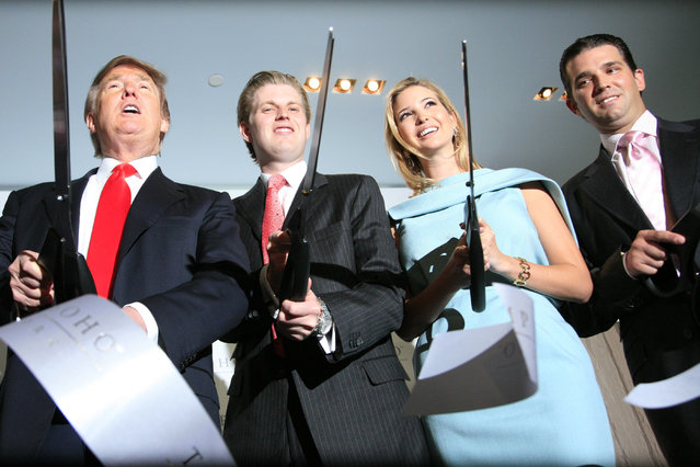 Donald Trump, left, chairman and CEO of the Trump Organization, cuts the ribbon with his children Eric, Ivanka, and Donald Trump, Jr. right, at the opening of the Trump SoHo New York, Friday, April 9, 2010. The 46 story hotel condominium has 391 units. (Photo by Mark Lennihan/AP Photo)