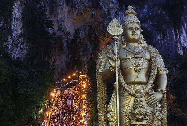 Hindu devotees climb the steps to Batu Caves temple during Thaipusam in Kuala Lumpur February 3, 2015. (Photo by Olivia Harris/Reuters)
