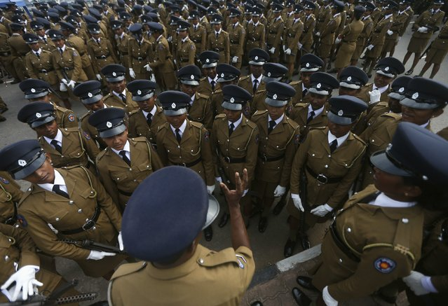 Women police officers are instructed by a police officer about their parade, before a rehearsal for Sri Lanka's 67th Independence Day celebrations in Colombo February 2, 2015. Sri Lankans will celebrate their Independence Day on February 4. (Photo by Dinuka Liyanawatte/Reuters)