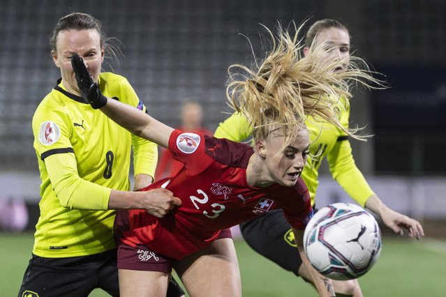 Swiss Alisha Lehmann, right, fights for the ball with Czech Republic's Jana Petrikova during the UEFA Women's Euro 2022 play-off 2nd leg qualification match between Switzerland and the Czech Republic at the Stockhorn Arena in Thun, Switzerland, 13 April 2021. (Photo by Alessandro Della Valle/EPA/EFE)