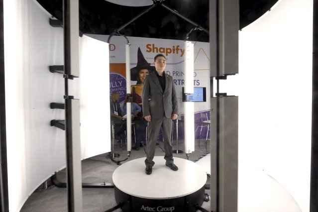 Ryan Miyaki stands in an Artec Shapify 3D body scanning booth during the 2016 CES trade show in Las Vegas, Nevada January 8, 2016. The booth can make a full body scan in 12 seconds and then sends the model file to the company, where a figurine is created. (Photo by Steve Marcus/Reuters)