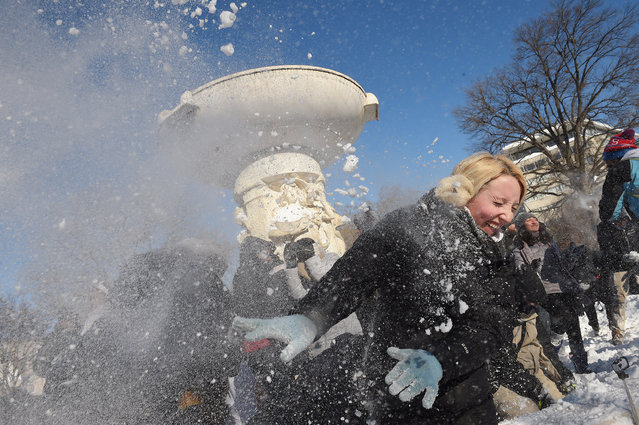 People take part in a large snowball fight in Dupont Circle on Sunday January 24, 2016 in Washington, DC. (Photo by Matt McClain/The Washington Post)