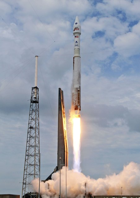 An AtlasV rocket, carrying the Maven spacecraft, blasts off at Cape Canaveral Air Force Station, Fla., on Monday, Nov. 18, 20131. Maven is on a 10-month journey will directly assess the atmosphere of the planet Mars. (Red Huber/Orlando Sentinel/MCT)