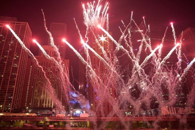 Fireworks light up the sky to bring in the new year during the annual Chi-Town Rising New Year's Eve celebration, along Upper Wacker Drive, Sunday, January 1, 2017, in Chicago. (Photo by Alyssa Pointer/Chicago Tribune via AP Photo)