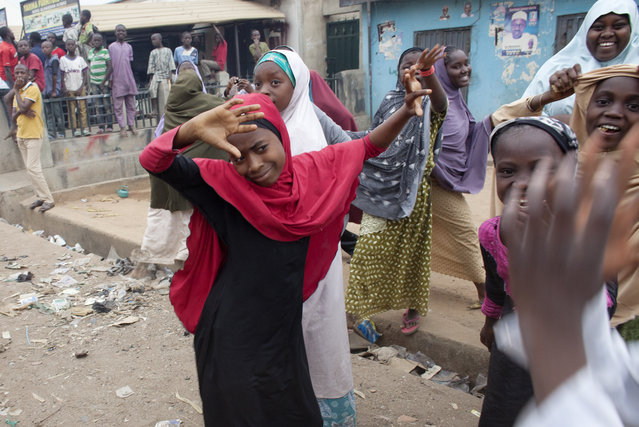 Children dance on the streets of Tundu Wada to celebrate the win of presidential candidate Muhammadu Buhari of the All Progressives Congress Party in Kaduna, Nigeria on Tuesday, March 31, 2015. (Photo by Jane Hahn/The Washington Post)