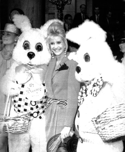 "April 15, 1990 Easter With Ivana: lvana Trump is joined by a pair of costumed Easter bunnies and cast members from the Broadway musical ""Meet Me in St. Louis"" outside the Plaza Hotel in New York, owned by her husband Donald but still managed by Ivana. An Easter brunch and fashion show with proceeds going to AIDS charity followed. (Photo by  Frankie Zinths/AP LaserColor)"