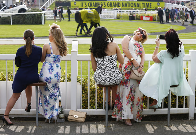 Horse Racing – Crabbie's Grand National Festival – Aintree Racecourse April 10, 2015: Women sit by the parade ring on ladies day during the Grand National. (Photo by Darren Staples/Reuters)