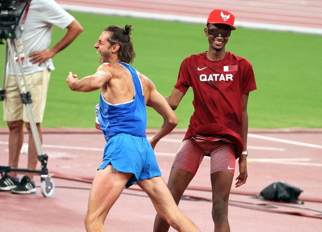 Gianmarco Tamberi of Italy and Mutaz Essa Barshim of Qatar share the Gold Medal in the Men's High Jump Final on day nine of the athletics events of the Tokyo 2020 Olympic Games at Olympic Stadium on August 1, 2021 in Tokyo, Japan. (Photo by Jean Catuffe/Getty Images)