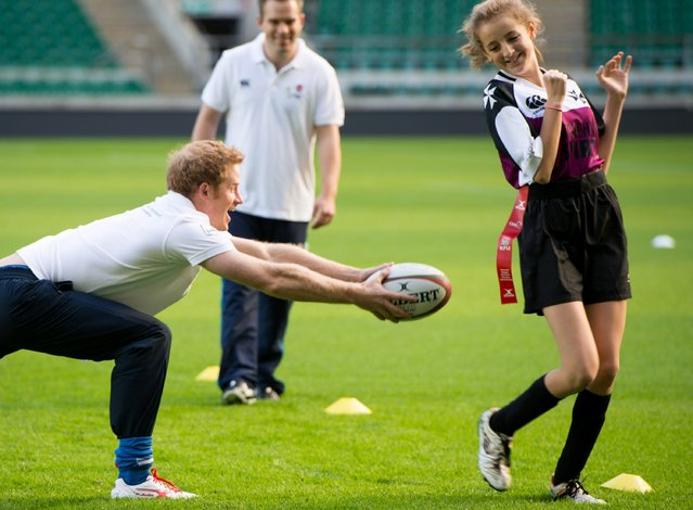 Prince Harry as he takes a coaching session for youngsters at Twickenham Stadium, London, on October 17, 2013. (Photo by Ian Gavan/PA Wire)