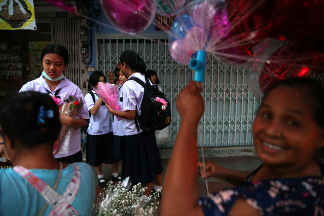 Students shop for flowers on Valentine's Day in Bangkok, Thailand on February 14, 2019. (Photo by Athit Perawongmetha/Reuters)