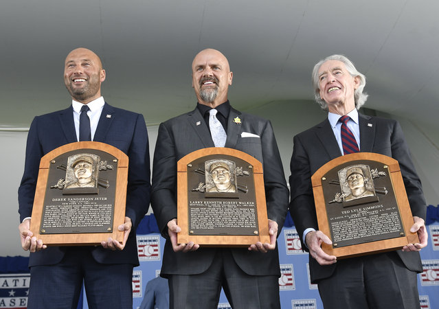 National Baseball Hall of Fame inductees  Derek Jeter, Larry Walker and Ted Simmons hold their plaques for photos after the induction ceremony at Clark Sports Center on Wednesday, September 8, 2021, in Cooperstown, N.Y. (Photo by Hans Pennink/AP Photo)